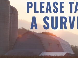 Please take a survey - Farm in background