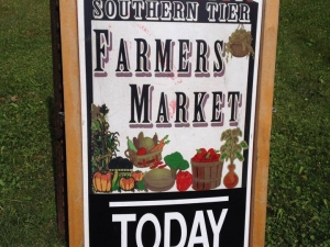 "Breadboard sign with ""Southern Tier Farmers' Market Today"""