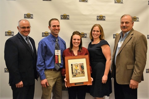 NYFB President David Fisher with Darin and Katie Hill of Cattaraugus County Farm Bureau, winners of the YF&R Achievement Award, NYFB YF&R Chair Kristen Brown and Bill Moller of Kubota