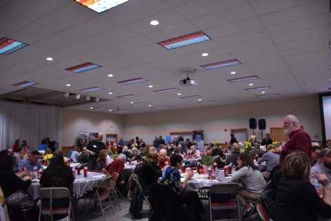 People eating at the 2018 Farmer-Neighbor Dinner at the West Valley Fire Hall