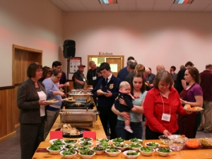 Participants making their plates of locally grown food