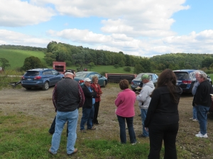 Jeff Goodyear, in green hat, talking to Ag tour group at Maple Ridge Bison Ranch