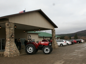 Front entrance to the West Valley Fire Hall with Case tractors from Lamb & Webster of Springville, NY