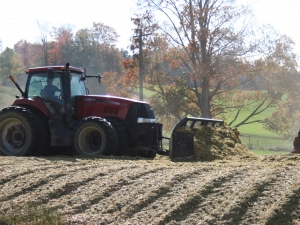 Tractor packing silage pile