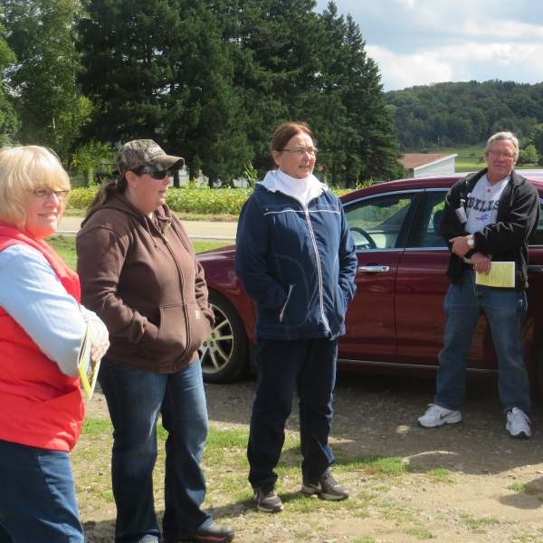 Litchfields talking to the Ag tour group about the Great Valley Berry Patch