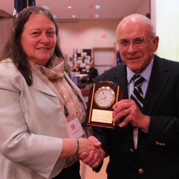 Joan Petzen receiving the Friend of Agriculture Award from Dave Zilker, Ag & Farm Development Board President. Credit: Rick Miller